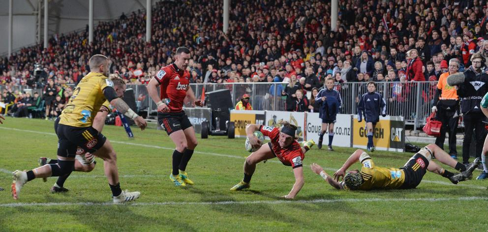 George Bridge of the Crusaders dives over to score a try. Photo: Getty Images