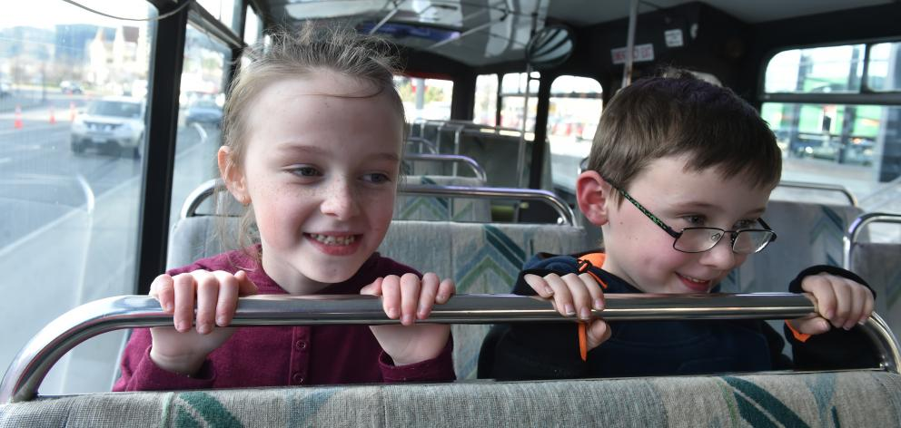 Ready for a ride on the Otago Museum's school holiday bus route are Kyla (7) and Toby (6) Rae, of Fairfield. About 50 people used the free inner-city loop bus on its first day of service yesterday. Photo: Gregor Richardson