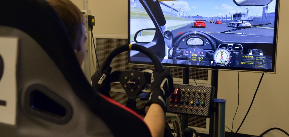 Peter Vodanovich (19) trains in the driving simulator at the School of Physical Education during...