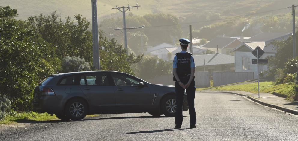 A police officer at a cordon in Tomahawk. Photo: Stephen Jaquiery