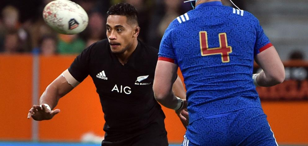 All Black loose forward Shannon Frizell looks towards the action along with French lock Bernard le Roux at Forsyth Barr Stadium last weekend. Photo: Peter McIntosh