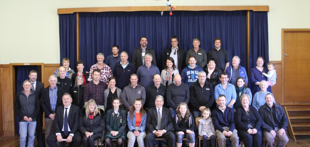 Acting Prime Minister Winston Peter (front centre), Regional Economic Development Minister Shane Jones (front far left) and New Zealand First MP Mark Patterson (second row second from left) celebrate with members of the Pourakino Catchment Group, after th