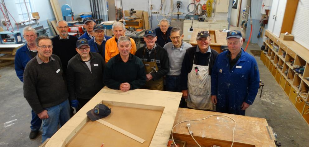 Taieri Blokes' Shed members gather in the workshop before this week's 10th anniversary celebrations.Photo: Brenda Harwood