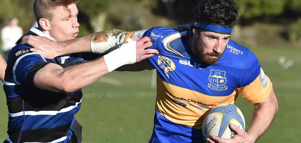 Taieri flanker Josh Brown attempts to fend off Kaikorai fullback Ben Miller at Bishopscourt on...