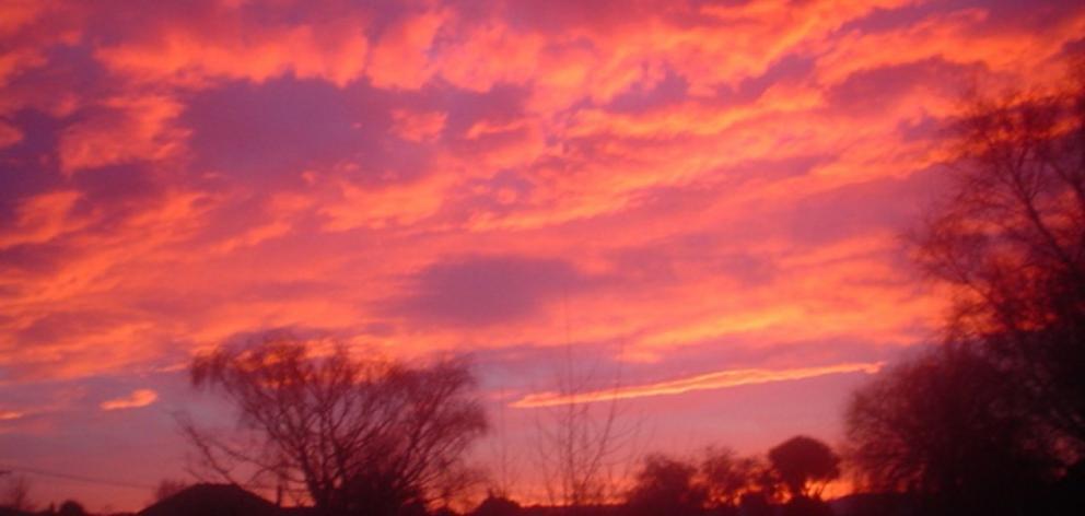 A vivid northwesterly sunrise over Oamaru last Thursday ahead of a very mild, spring-like day....