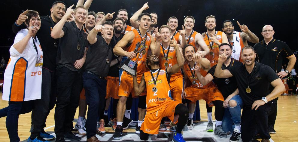 The Southland Sharks celebrate after beating the Wellington Saints in the NBL final in Wellington...