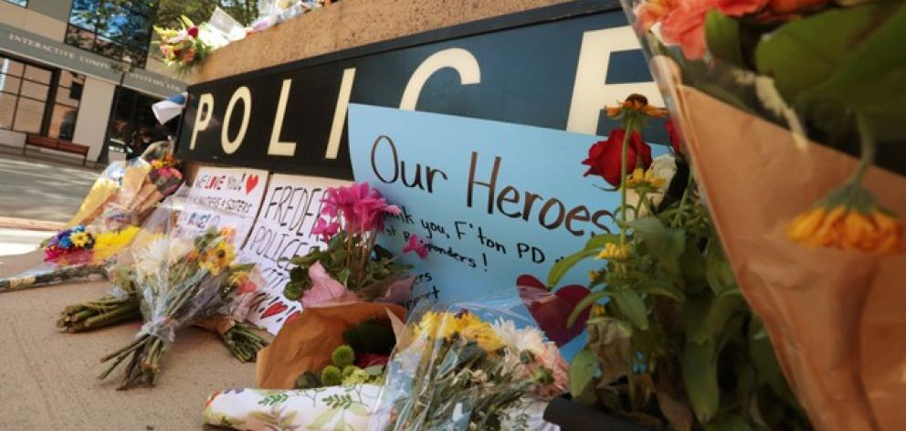 A makeshift memorial has been forming outside Fredericton Police Headquarters in Fredericto. Photo: Reuters