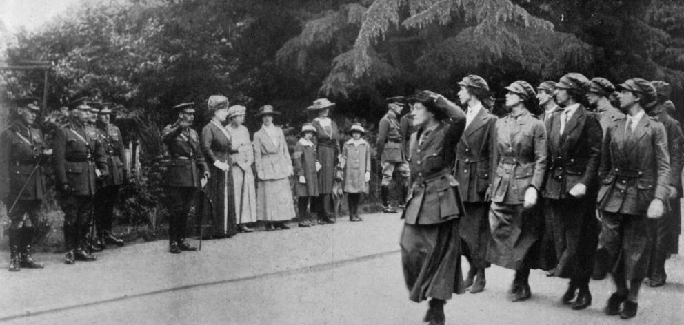 Women mechanical transport drivers marching past a royal party at Aldershot, comprising the King, Queen, Princess Mary and the Duke of Connaught. - Otago Witness, 14.8.1918.