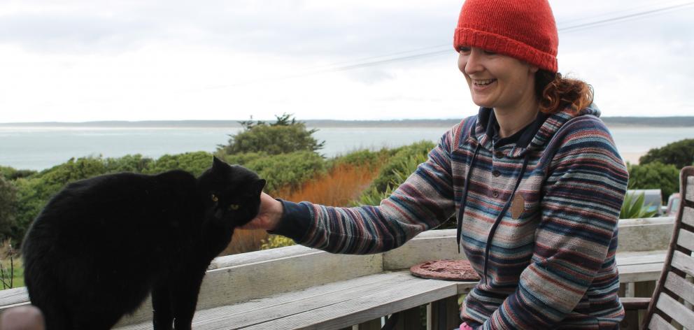 Nico Jarvis with Omaui neighbour's cat, Nhabuz Fishaw. Photo: Sharon Reece