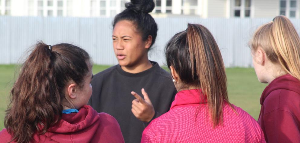 Contracted Black Ferns player Alena Saili gives tips at a Southland Girls' High School First XV...