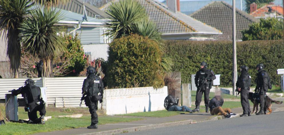 Police detain two people in Miller St, Invercargill, yesterday morning in relation to a shooting...