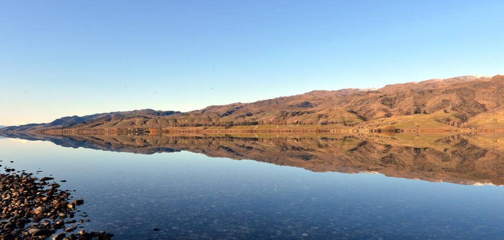Lake Dunstan, formed after completion of the Clyde dam, owned by Contact Energy. The lake began...