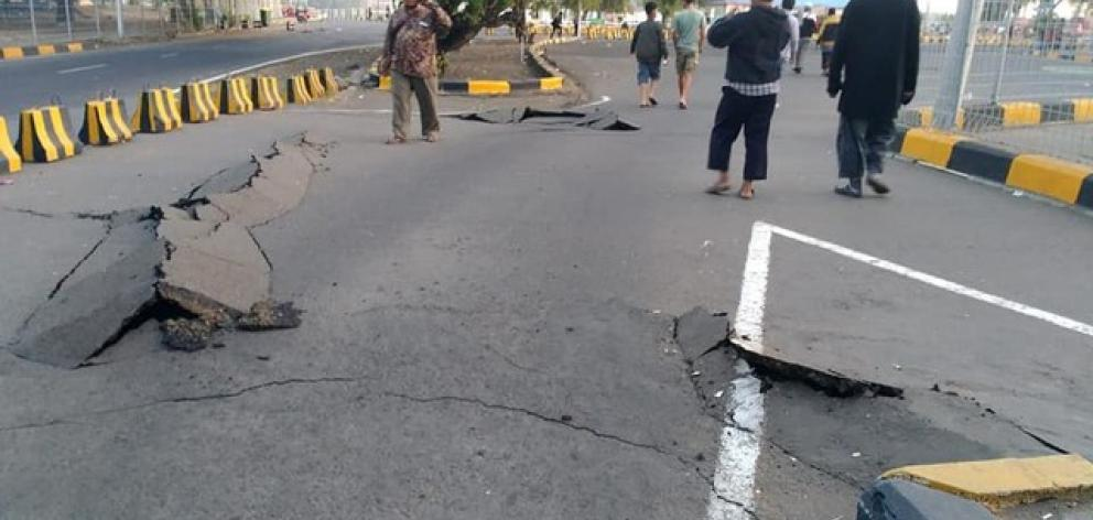 A crack emerges on a road at Kayangan Port after an earthquake hit Lombok. Photo: Bayu Wiguna via Reuters