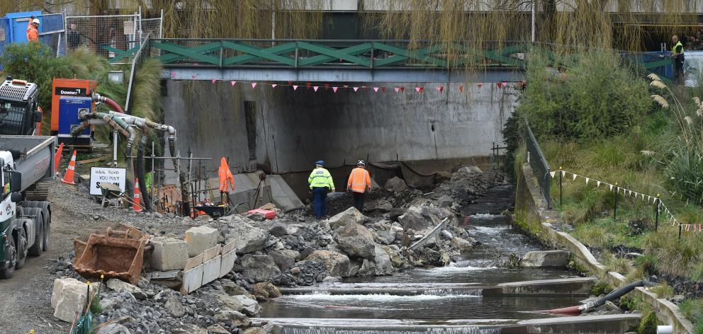Police investigate a building site in the Water of Leith yesterday. Photo: Gregor Richardson