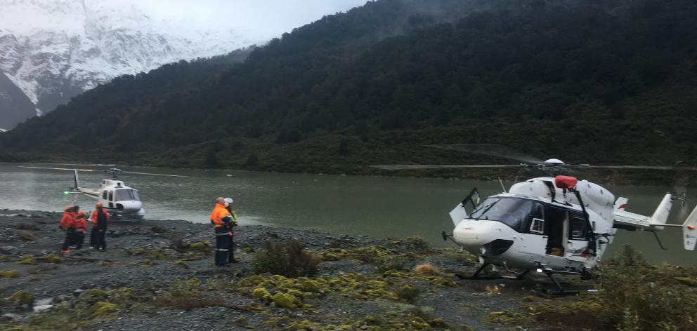 Southern Lakes Helicopters waiting for the weather to clear to pick up the Australian climber. Photo: Southern Lakes Helicopters