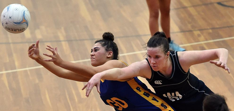 Phys Ed's Mariah Nelson (left) and Southern Magpies' Sophie Erwood compete for the ball during...