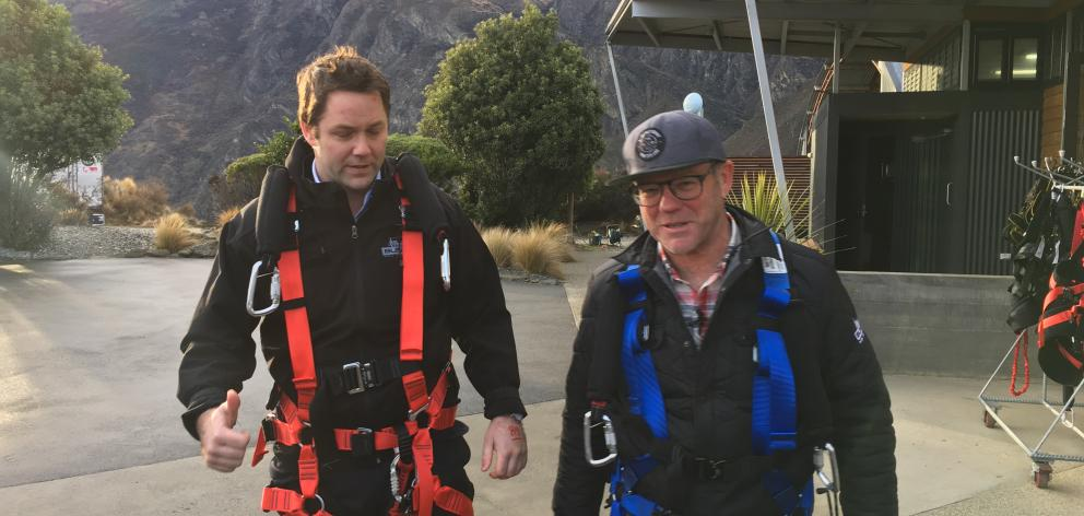 Clutha Southland MP Hamish Walker and AJ Hackett Bungy founder Henry van Asch ready to be launched on the Catapult, the company's latest adventure ride, which will be launched this morning. Photo: Joshua Walton