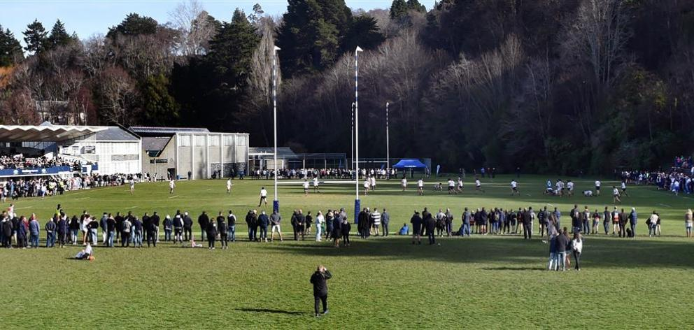 A large crowd watches the action between Otago Boys' High School and John McGlashan College during the final of the Otago Premier Schools tournament at Littlebourne on Saturday. Photo: Peter McIntosh