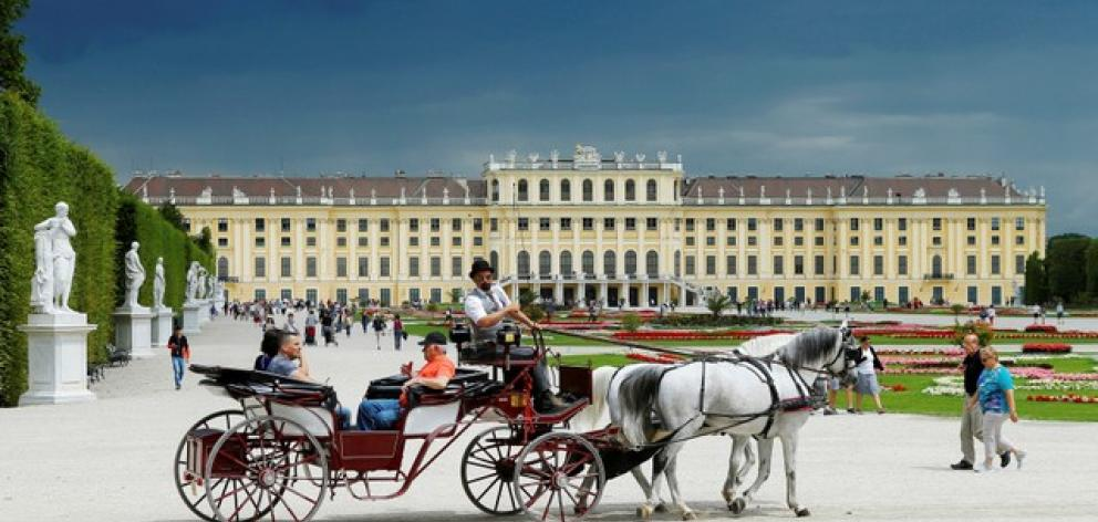 A traditional Fiaker horse carriage passes imperial Schoenbrunn palace in Vienna. Photo: Reuters
