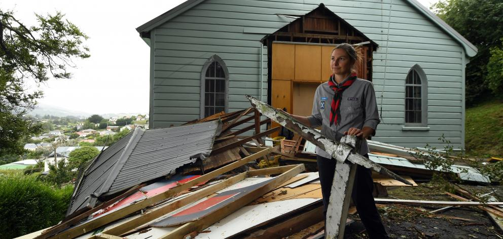 Roslyn Scouts group leader Kim Cousins surveys the damage to the Roslyn scout hall in February...