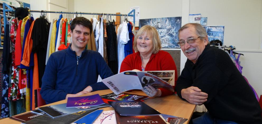 Taieri Musical Society members (from left) vice-president Blair Hughson, Ovation show director Helen Horsnell and committee member Bruce McDowell browse over programmes from past shows at they look forward to the society's 50th anniversary celebrations in