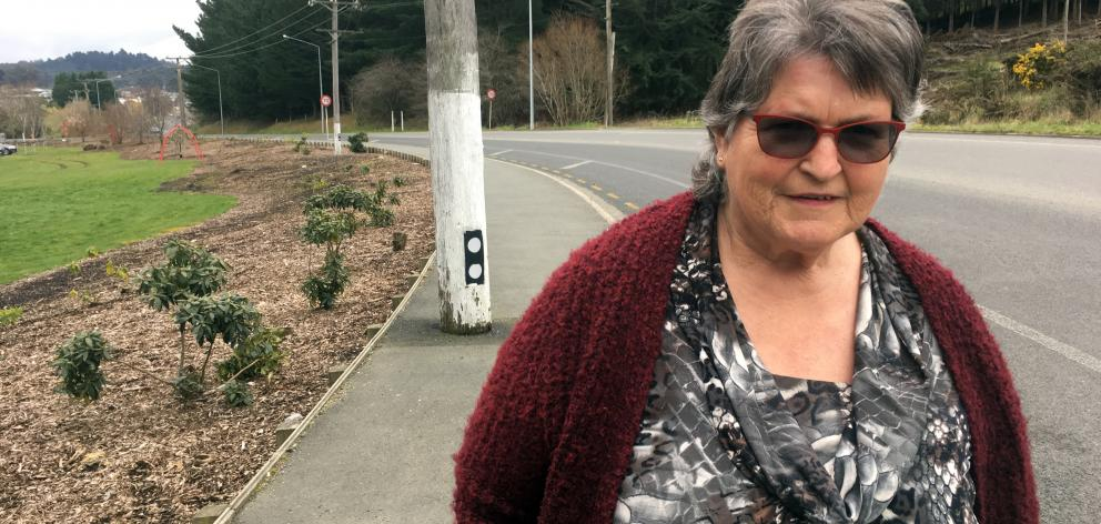 Pam Harris, of Sunnyvale, believes the position of a power pole on a footpath in Main South Rd poses a danger to pedestrians.  Photo: Shawn McAvinue