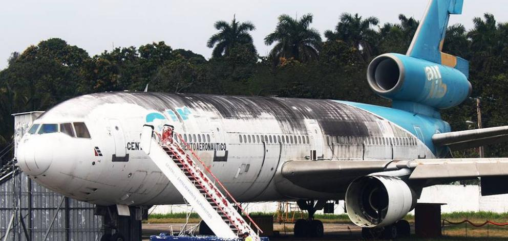 The former Air New Zealand DC10, parked at Havana Airport, Cuba, that a group of aviation...