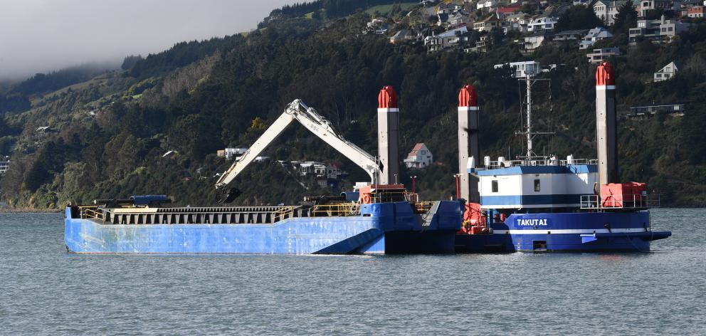 Port Otago's $8million backhoe dredge Takutai works in the upper reaches of Otago Harbour in July. Photo: Stephen Jaquiery