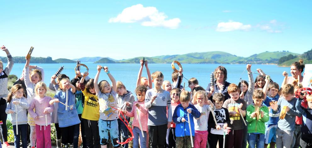 St Leonards school pupils, teacher aides and teachers participated in the 1pm bell ringing yesterday to welcome home royal albatrosses to Taiaroa Head. Photo: Christine O'Connor