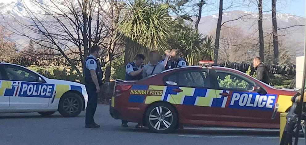 Police arrest a man after a long chase that ended at the BP petrol station in Frankton. Photo:...
