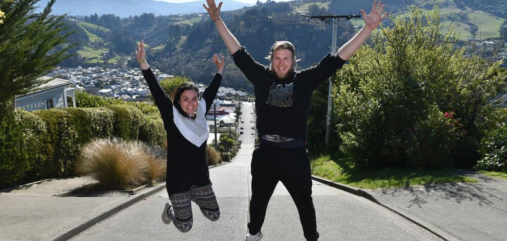 Backpackers Sabrina Zanin,  of Italy, and Malte Sturmann,  of Germany,  celebrate getting to the...