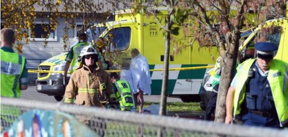 Police and ambulance staff at South End School in Carterton. Students have fallen sick after an...