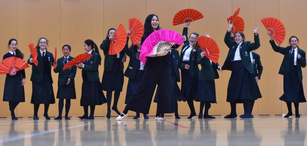 Chinese folk dance teacher Yujia Song, of Christchurch, teaches year 9 Columba College pupils a traditional Chinese dance using fans, as part of New Zealand Chinese Language Week. Photo: Peter McIntosh