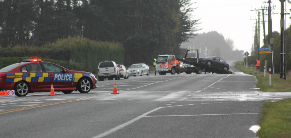 A car gets towed following a two-car crash in Invercargill this morning. Photo: Sharon Reece