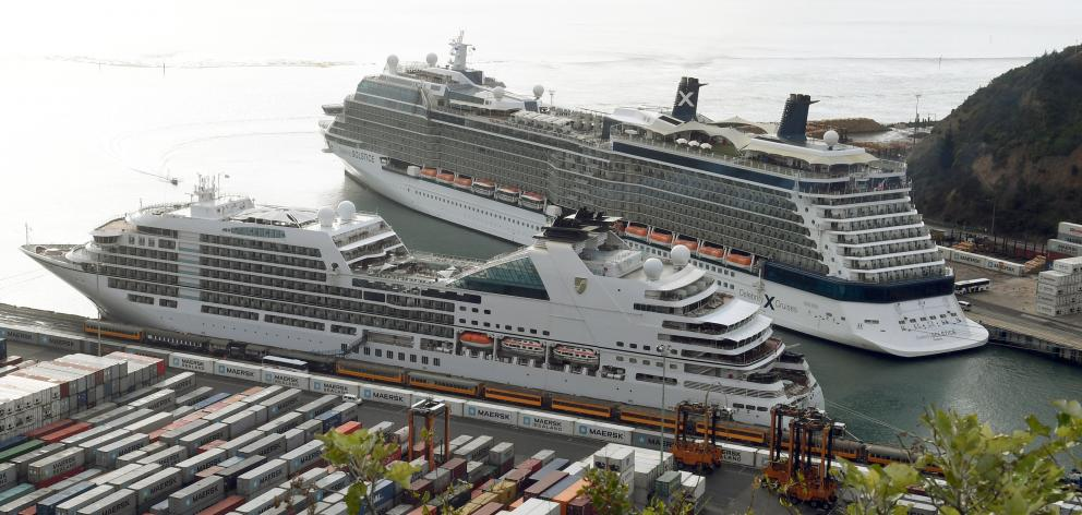 Cruise ships, 'Seabourn Encore' (front) and 'Celebrity Solstice' berthed at Port Chalmers last year. Photo: Stephen Jaquiery