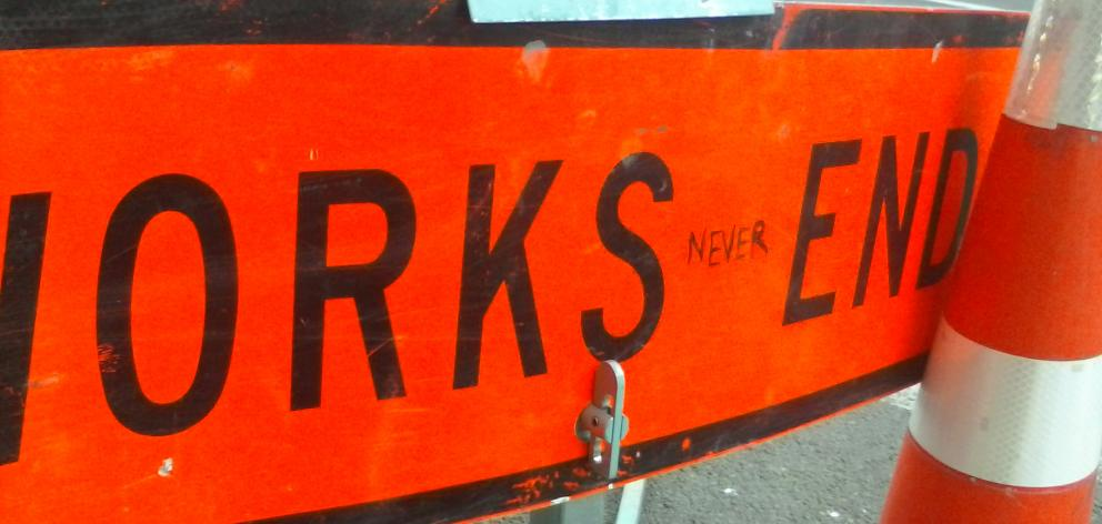 Many around Dunedin will sympathise with this telling piece of roadworks rage on a sign in Moray Pl. Photo: Peter Dowden