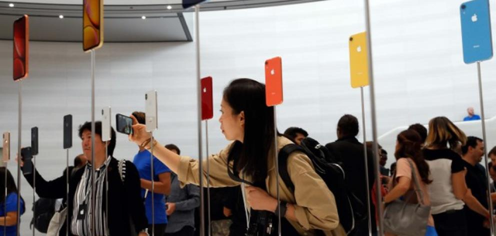 A demonstration of the newly released Apple products is seen following the product launch event in Cupertino. Photo: Reuters