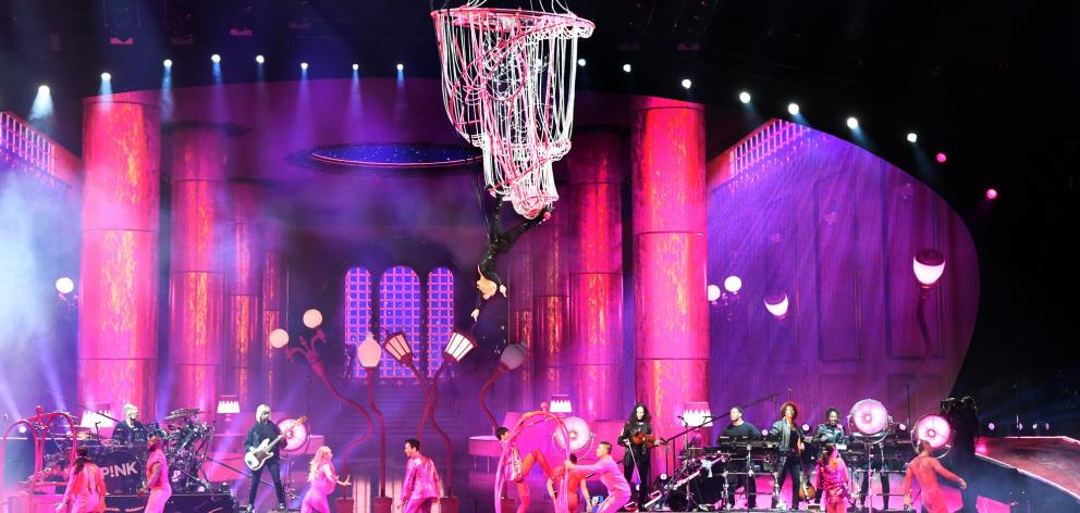 Pink makes a dramatic chandelier-swinging entrance to start her Dunedin show.