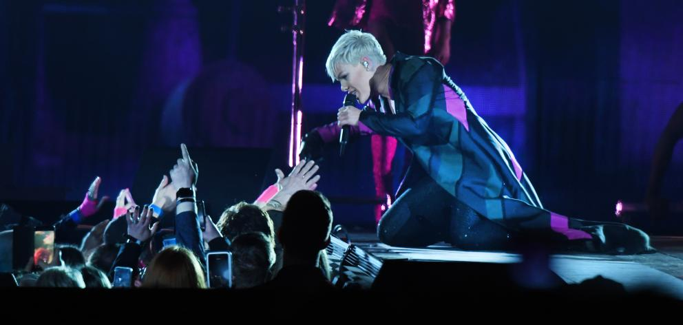 Pop star Pink reaches into an adoring crowd at Forsyth Barr Stadium for the first New Zealand...