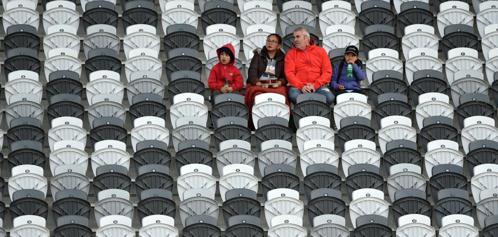 A small group of fans have plenty of seats from which to choose in the South Stand at Forsyth...
