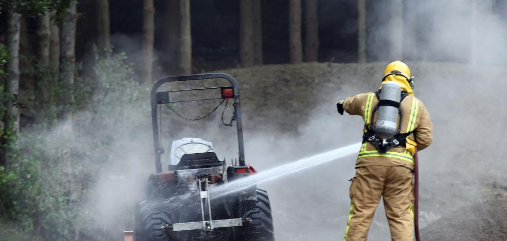 Firefighters extinguish yesterday's  tractor blaze. Peter McIntosh