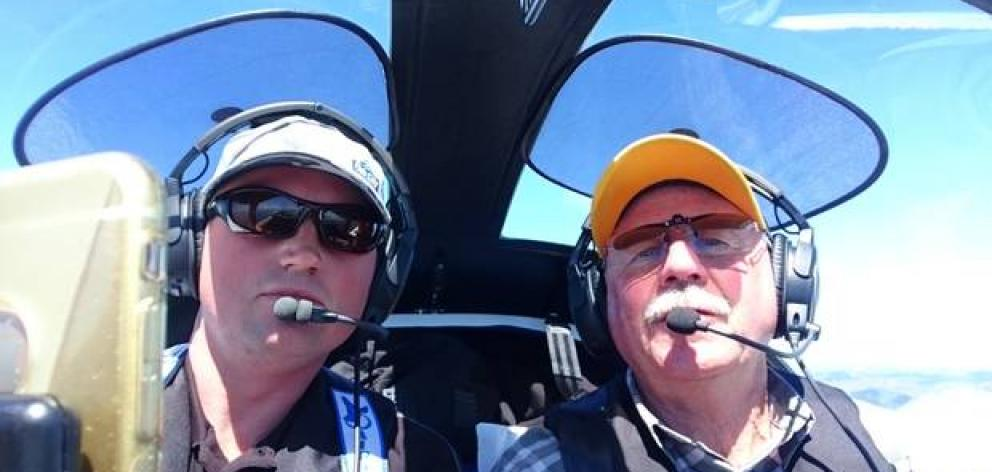 Jeff Weake, left, and Trevor Barrett on one of their flights north from the South Island. Photo: Supplied via NZ Herald