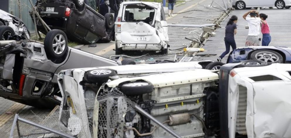 Vehicles damaged by Typhoon Jebi are seen in Osaka. Photo: Reuters