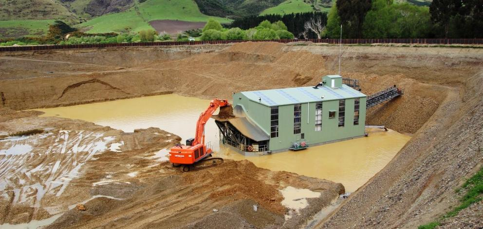 Waikaia Gold's floating dredge, shortly after it was commissioned in late 2013, in Northern Southland. Photo: Supplied