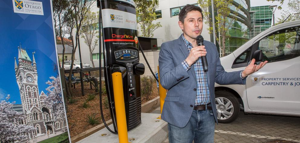 Green MP Gareth Hughes speaks at the formal opening of a new rapid charger for electric vehicles,...