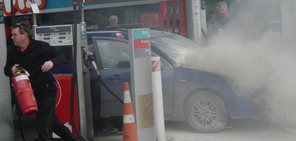 The engine of a car caught fire on the forecourt of the Balclutha Caltex this afternoon. Photo: Richard Davison
