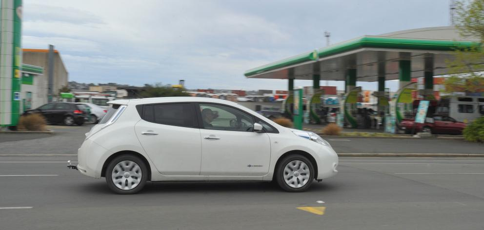 An electric vehicle passes the BP petrol station in Cumberland St yesterday. PHOTO: GREGOR...