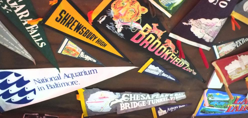 Some of many pennants that adorn a ceiling in Rick's Garage.