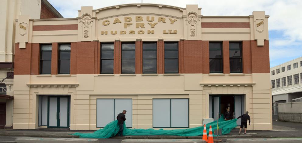 The restored facade of the former Cadbury factory's old dairy building was revealed yesterday....