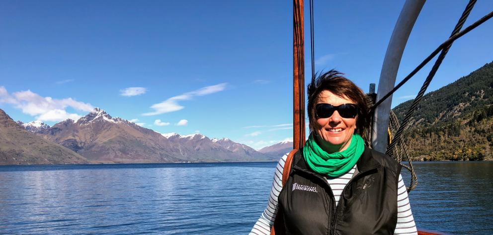 Katrina Bishop on a boat on the way to work at Walter Peak Station earlier this month. Photo:...